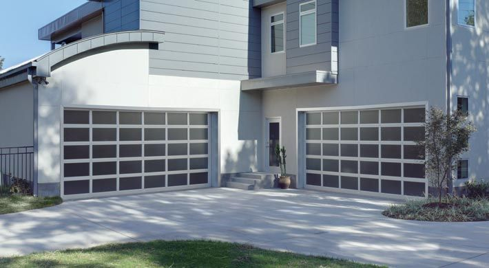 Vista Garage Door Clean Simple Lines And A Full View With This Contemporary Garage Door R Value N Garage Doors Contemporary Garage Doors Garage Exterior