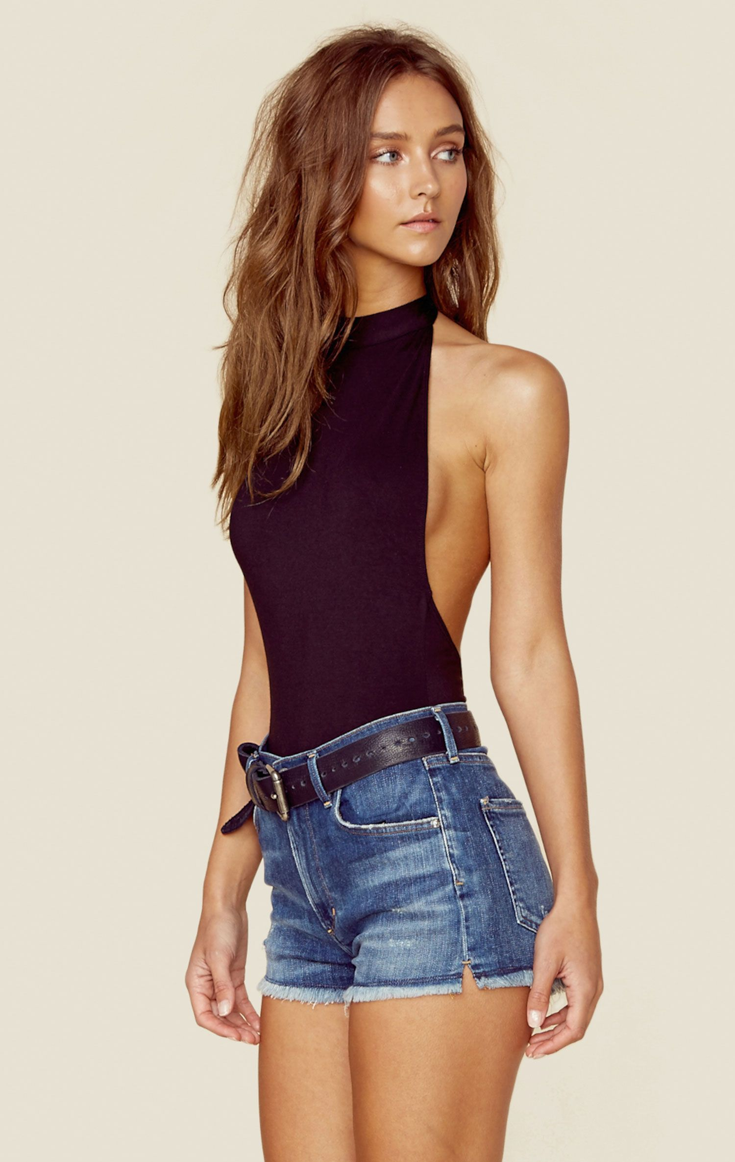 99c40b2f36 The Dancing Days Bodysuit features a super chic mock turtleneck with open  back and cheeky bottom.Made in USAMachine Wash ColdSpandex ModalFit  Guide Model is ...