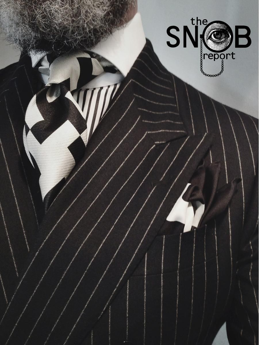 Double-breasted charcoal suit by Oger, MTM black stripe contrasting collar shirt Emanuel Berg for Lowet Tailors, big bold houndstooth tie by Chester Barrie & Tom Ford pocket-square