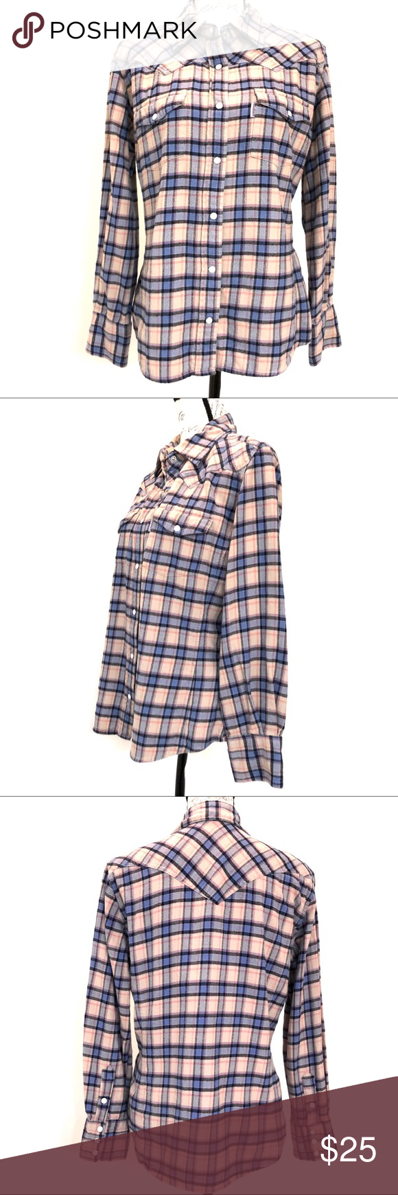 """Carhartt Women's Pearl Snap Button Flannel Shirt Carhartt Women's Blue, Pink & Cream Plaid Flannel Shirt Pearl Snap Button Front Pearl Snap Button on Cuffs 2 Flap Front Pockets  Western style detailing Excellent used condition with no visible flaws, rips or stains.  Measurements laying flat approximately  Pit to Pit 22"""" Length 25"""" Carhartt Tops Button Down Shirts #carharttwomen"""