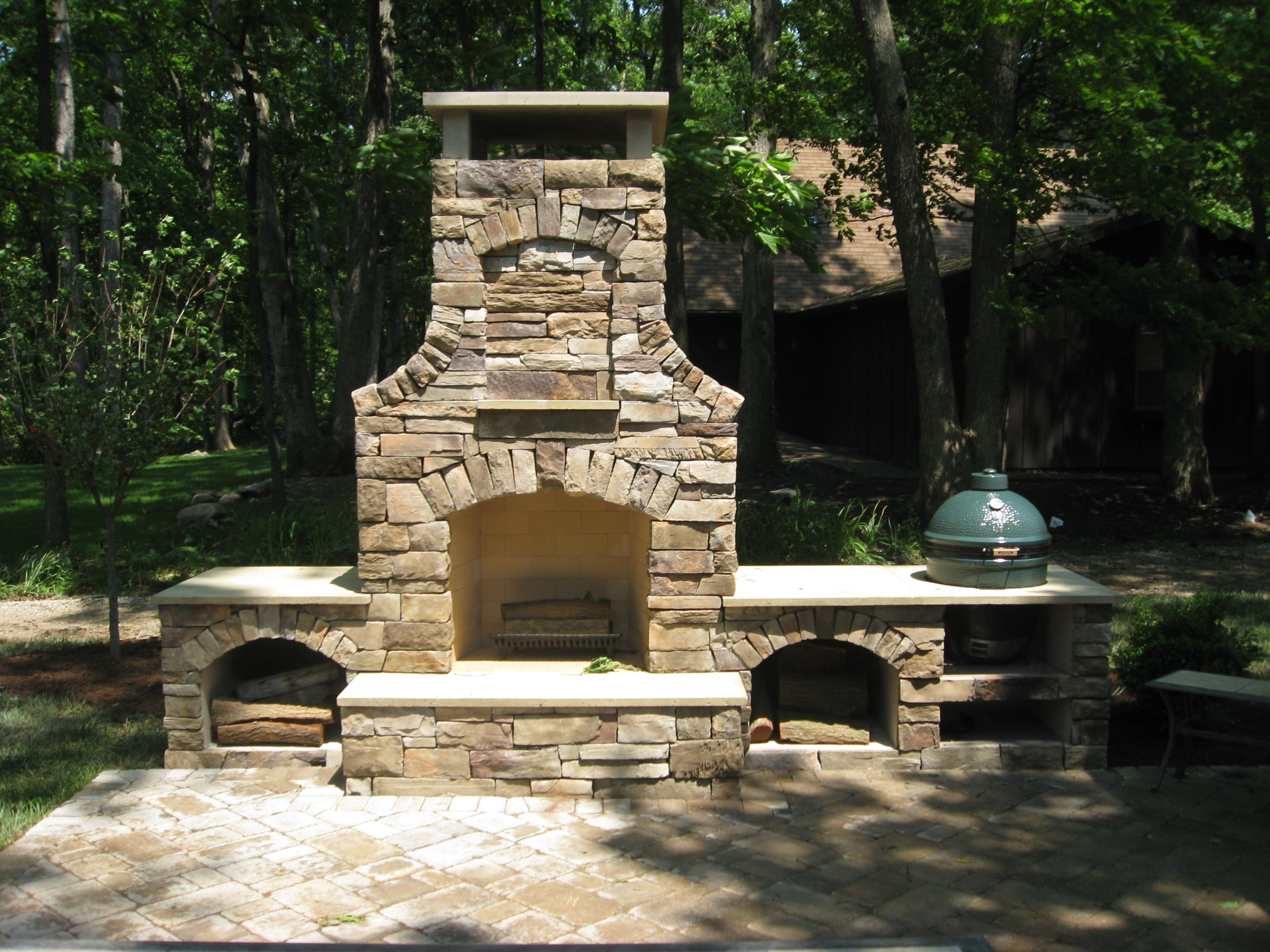 Outdoor Fireplaces u Firepits Big Green Egg keeping warm by the