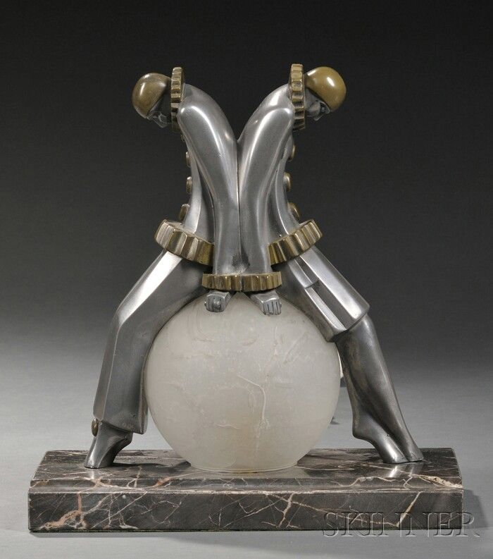 Art Deco Pewter Table Lamp with Figures, 20th century,Pierrot & Pierrette sitting atop a glass orb on a rectangular grey marble bas.