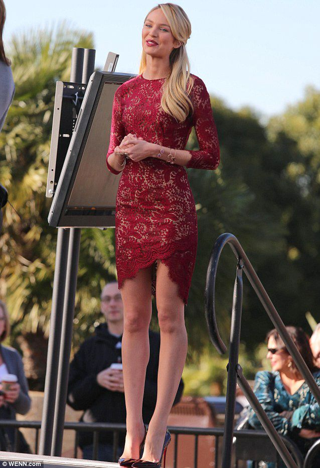 0882ae826c Candice Swanepoel wears the  Mia  Asymmetric Dress.