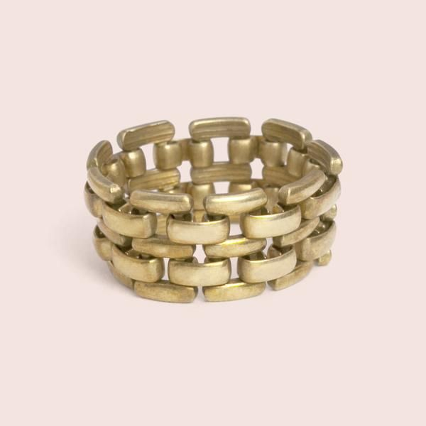 This thick band was inspired by similar antique men's rings from the mid-twentieth century.  I've always wanted one, but they're always heavy (aka expensive) gold and way too big for me. Here, we've made a more affordable version in sizes a lady can actually wear.  These are flexible brass, made from American-made 70's-era vintage chain.  They look incredible in a stack with other rings.  Available in whole sizes 5-12.  (So dudes can wear them, too).  3/8