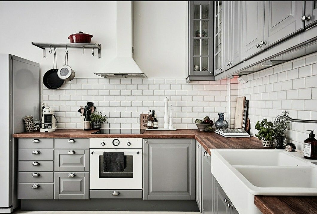 stockholm apartment with grey ikea kitchen cabinets white appliances and gorgeous dark wood on kitchen ideas cabinets id=61110