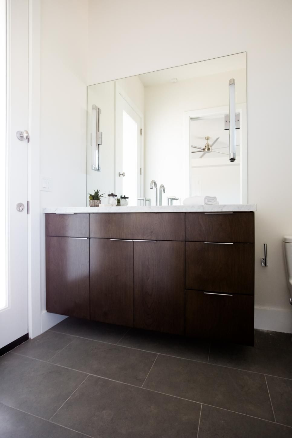 Slim Bathroom Cabinet: To Add A Touch Of Drama And Depth To This Otherwise White