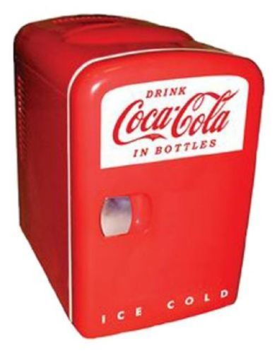 Koolatron-KWC-4-Coca-Cola-Personal-6-Can-Mini-Fridge I have a friend that loves Coke stuff for her kitchen she would love this!!