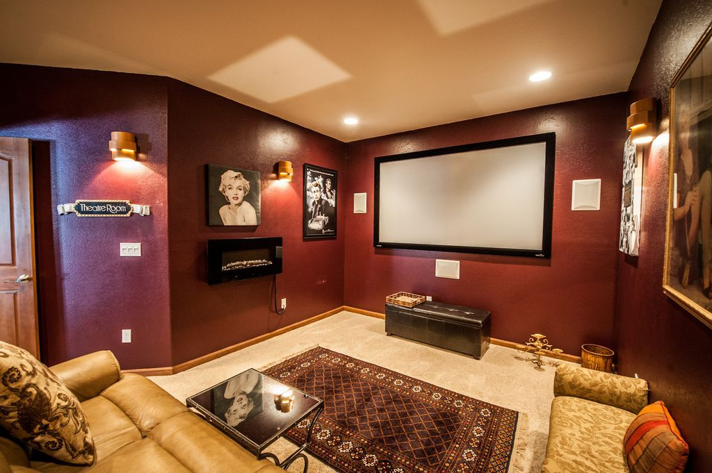 Traditional home theater with carpet high ceiling wall