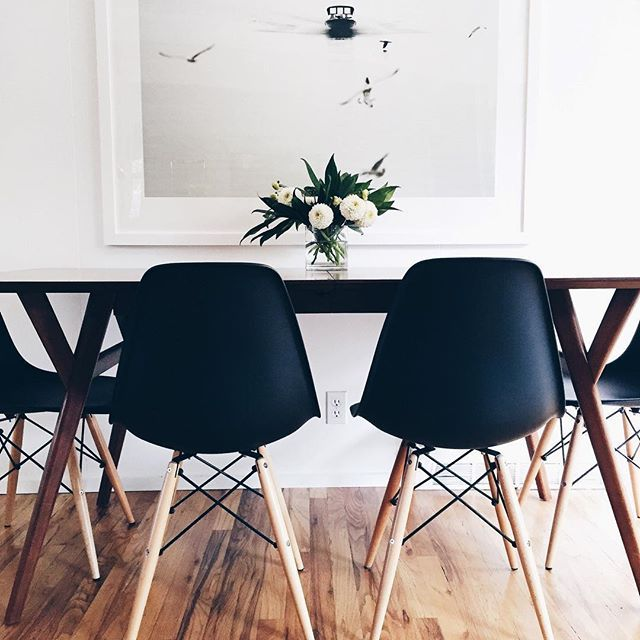Modern Simple Dining Room With White Walls And Eames Chairs