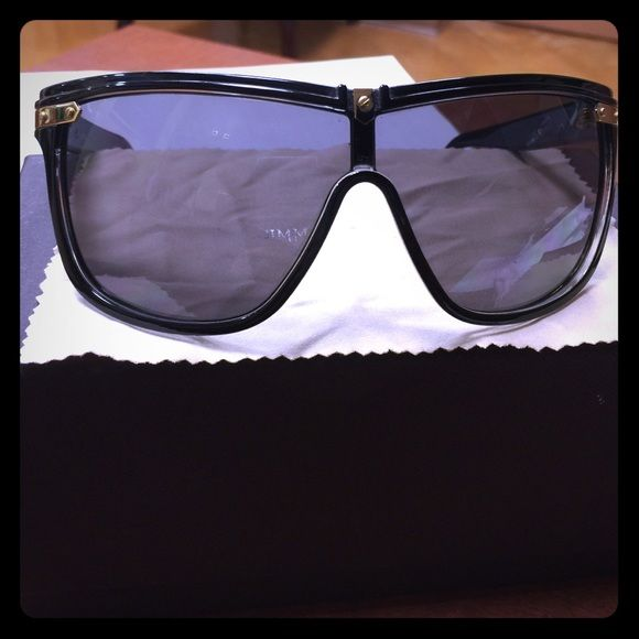 Jimmy Choo Sunglasses Jimmy Choo Sunglasses- only used a few times with signs of wear as noted in the pictures. Black/ Gold. Orig case not included but I can give you a Gucci case at no cost. Jimmy Choo Accessories Sunglasses