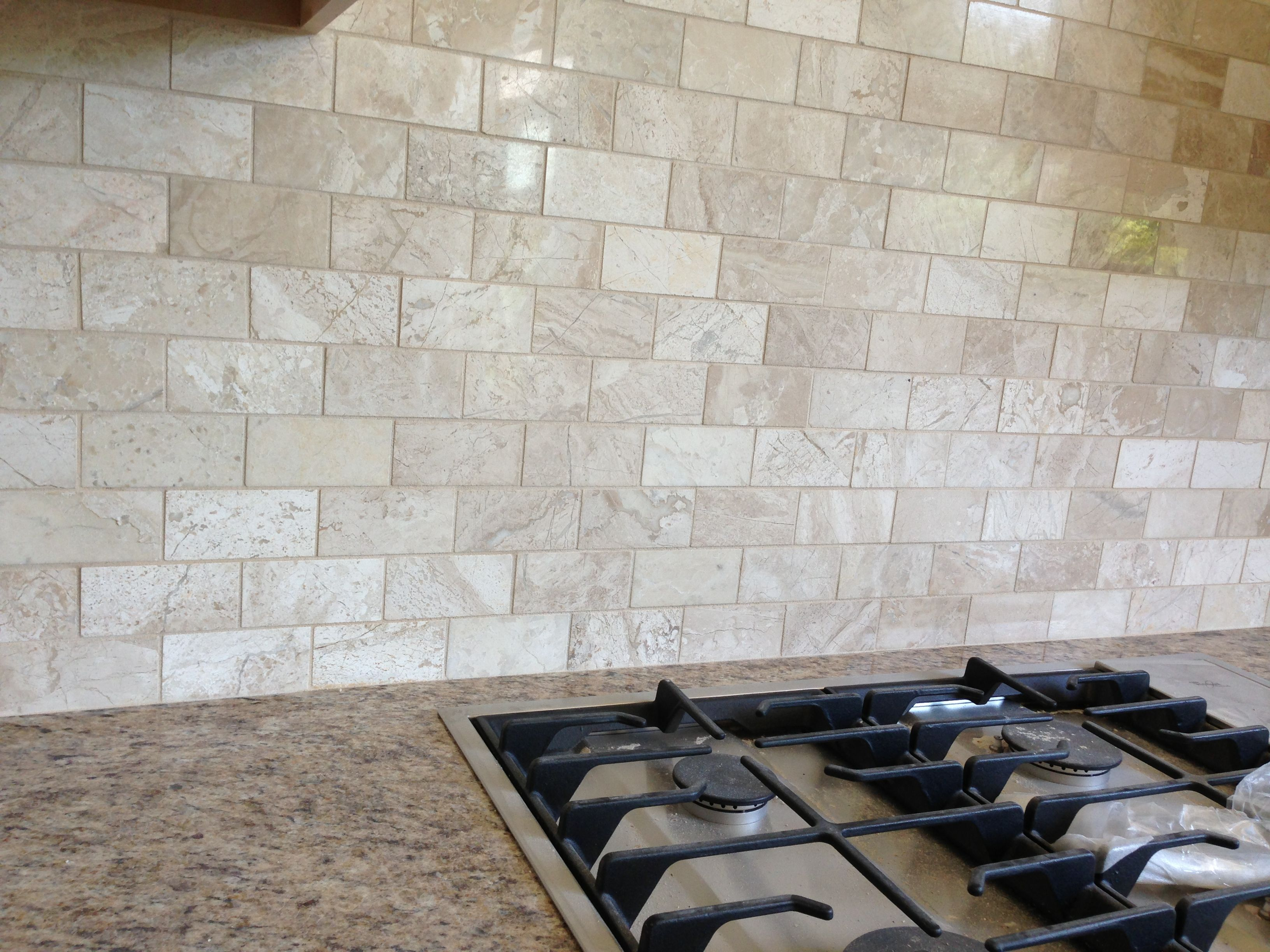 Queen beige marble backsplash