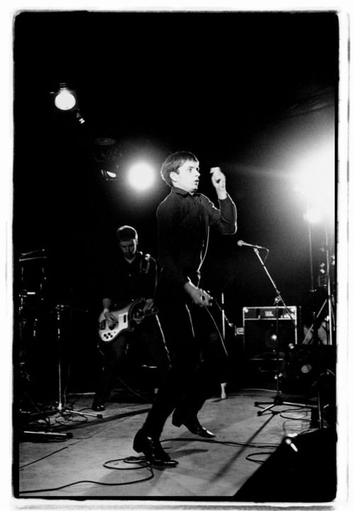 Joy Division: Ian Curtis and Peter Hook, Fac 15 Zoo meets Factory Half Way Leigh Festival, photo by Kevin Cummins Lancashire, August 1979