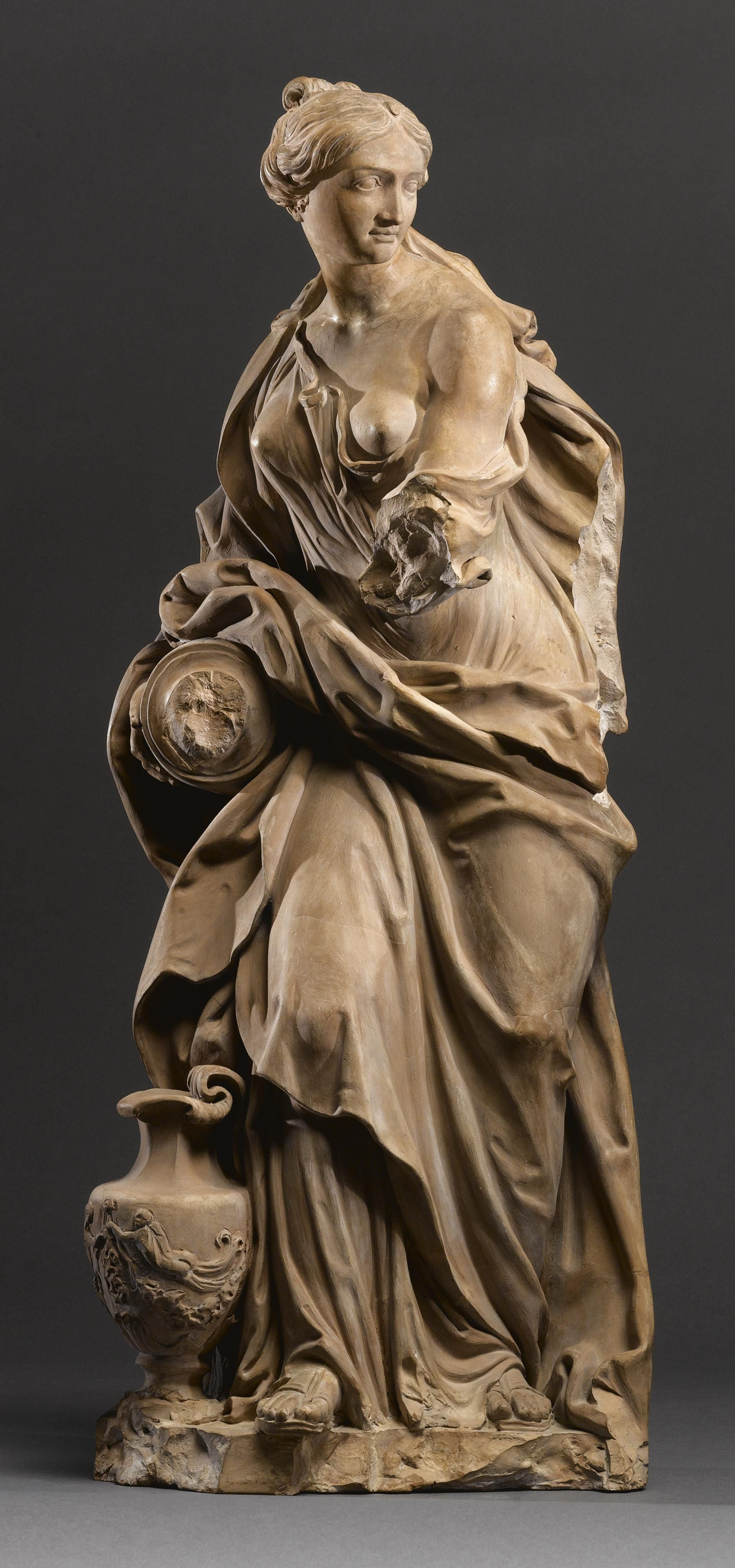 An Italian terracotta allegorical figure of Temperance, by Filippo Della Valle (1698-1768), first half 18th century.