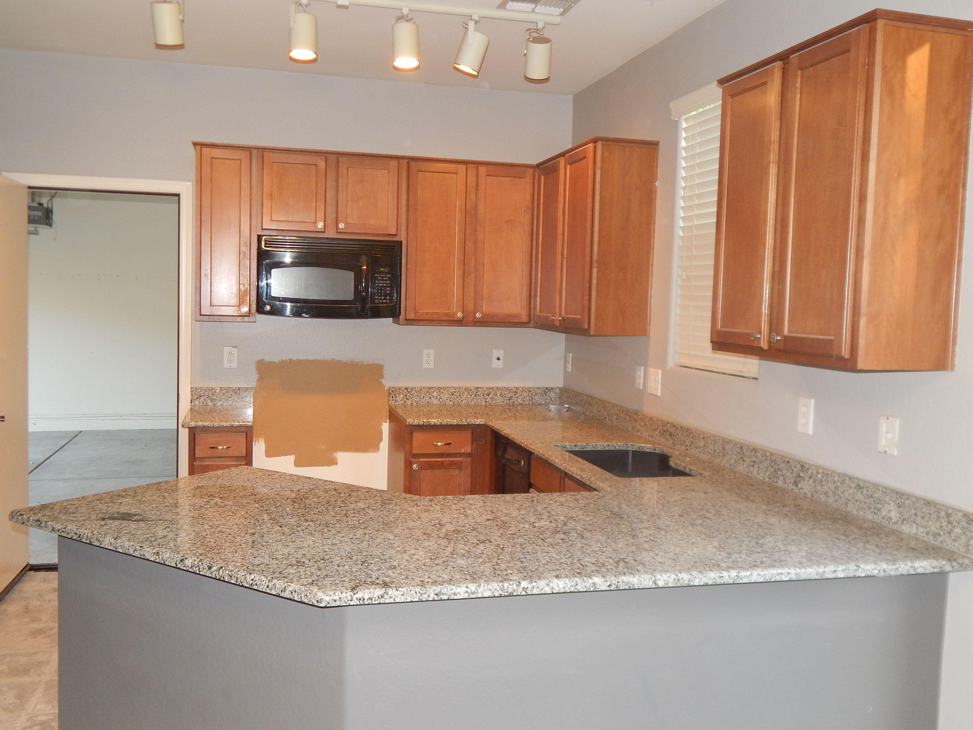 Kitchen remodel with Azul Platino granite and top radius edge