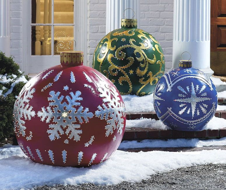 Massive Outdoor Lighted Christmas Ornaments http://www.thegreenhead.com/2008 - Massive Outdoor Lighted Christmas Ornaments Christmas Cottage