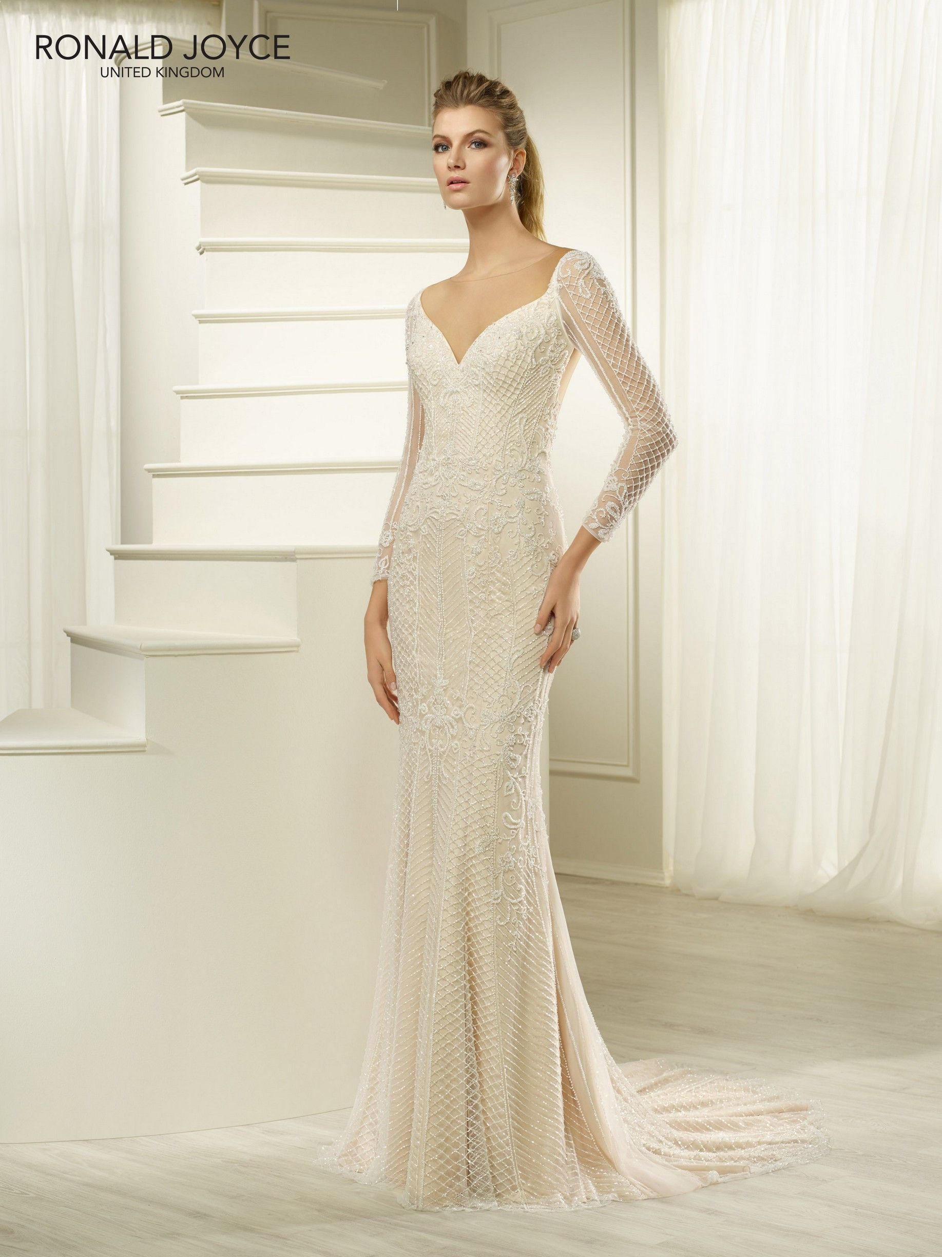 Back out wedding dresses  Ronald Joyce Hatsy wedding dress SLEEVES AND AN ILLUSION CUTOUT