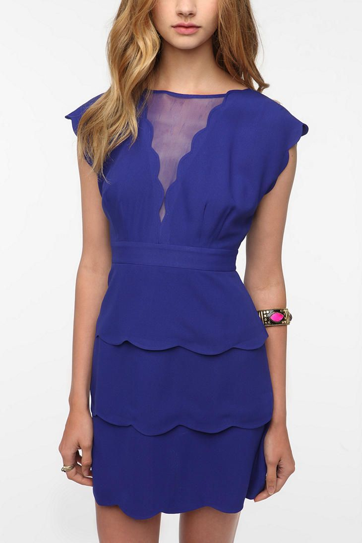 Love the colour and the fact that it\'s peplum. Plus, the scallop ...