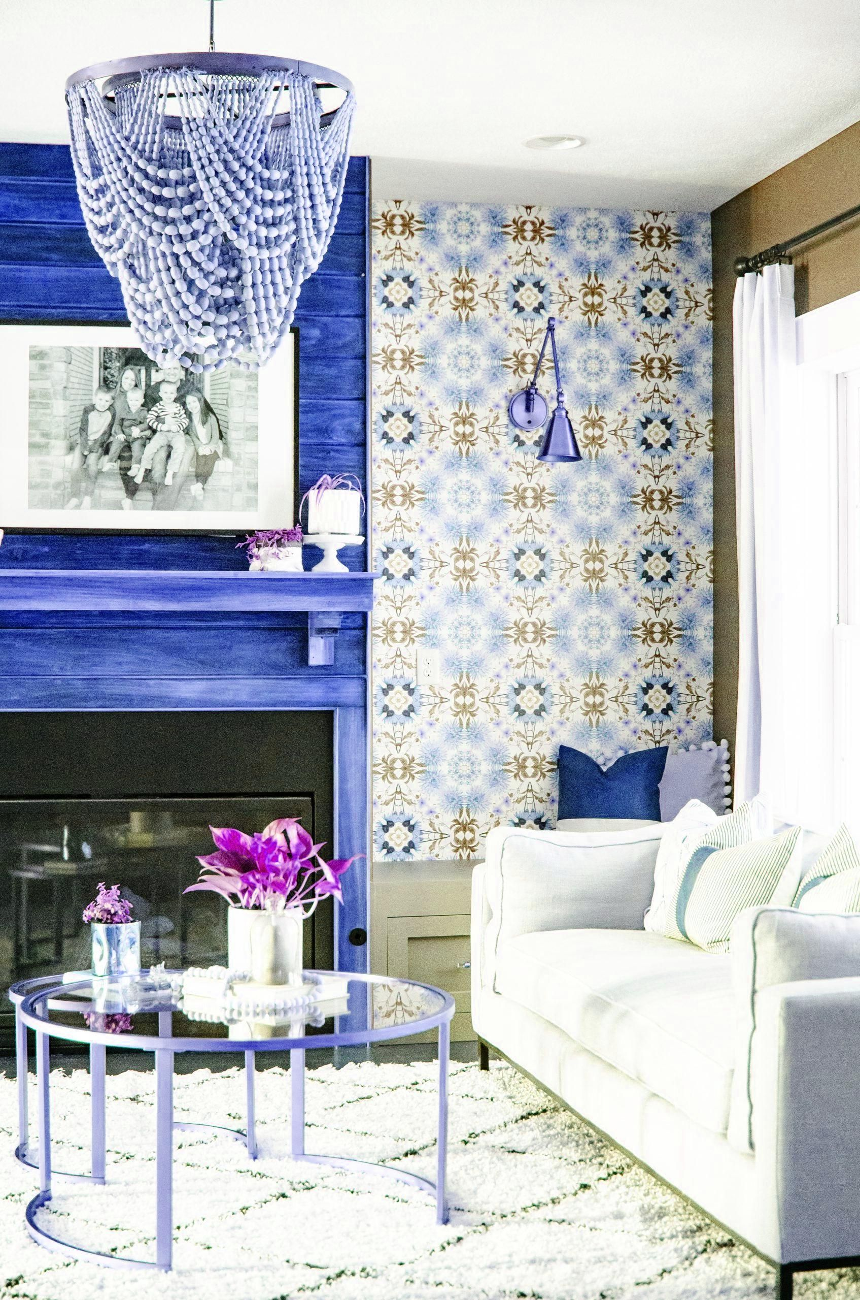 Home Remodel Must Haves Beaded Chandelier and a bold wallpaper accent wall make a statement in this modern boho inspired living room. Click link for sources and before & after photos. #sherwinwilliamspaint #roomdecor.Home Remodel Must Haves  Beaded Chandelier and a bold wallpaper accent wall make a statement in this modern boho inspired living room. Click link for sources and before & after photos. #sherwinwilliamspaint #roomdecor