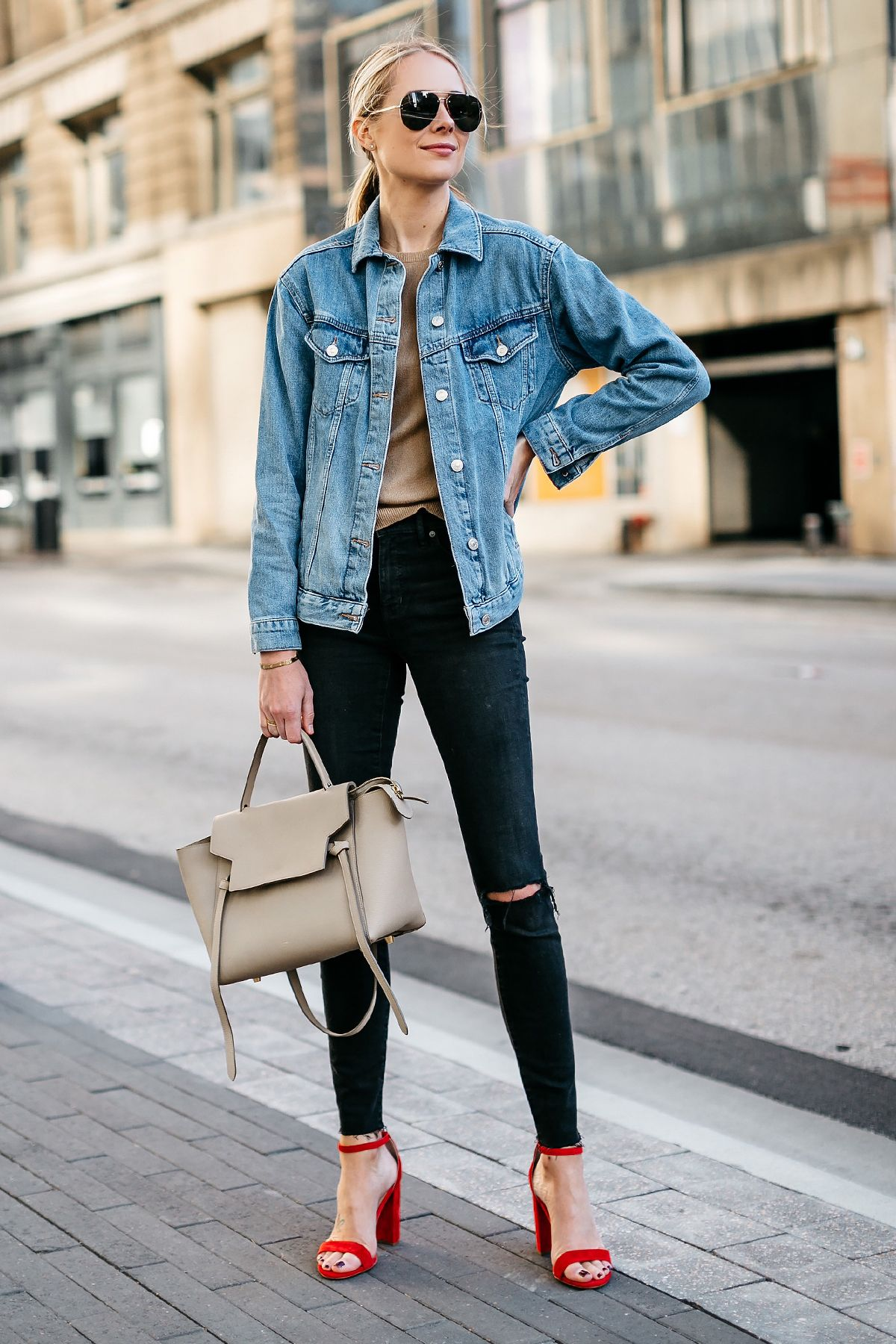 8b314d2a27 Blonde Woman Wearing Topshop Oversized Denim Jacket Tan Sweater Black  Ripped Skinny Jeans Celine Mini Belt Bag Celine Aviator Sunglasses Red  Ankle Strap ...