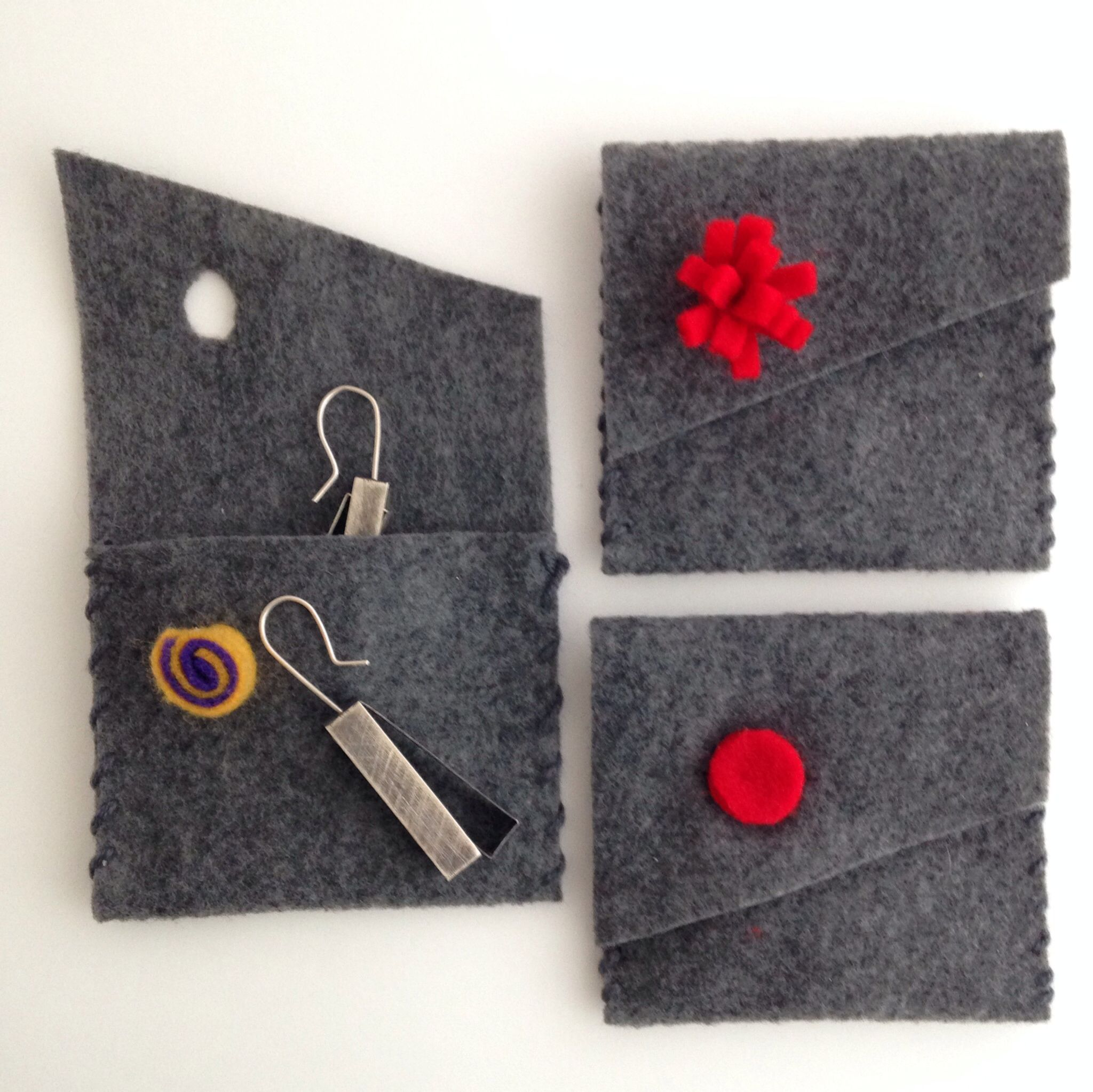 Simple felt envelopes with interesting button will likely be retained by the buyer to keep their jewellery in. | Brand: Donald & Jane