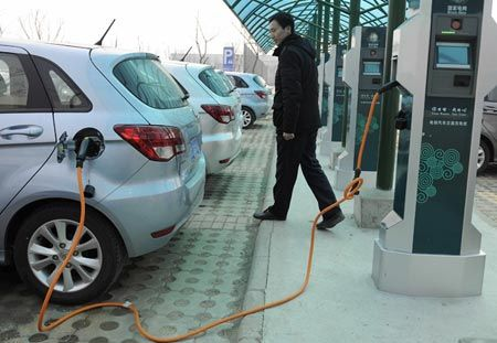 An electric car charging at a station in Beijing, March 2013. (Photo/CNS)