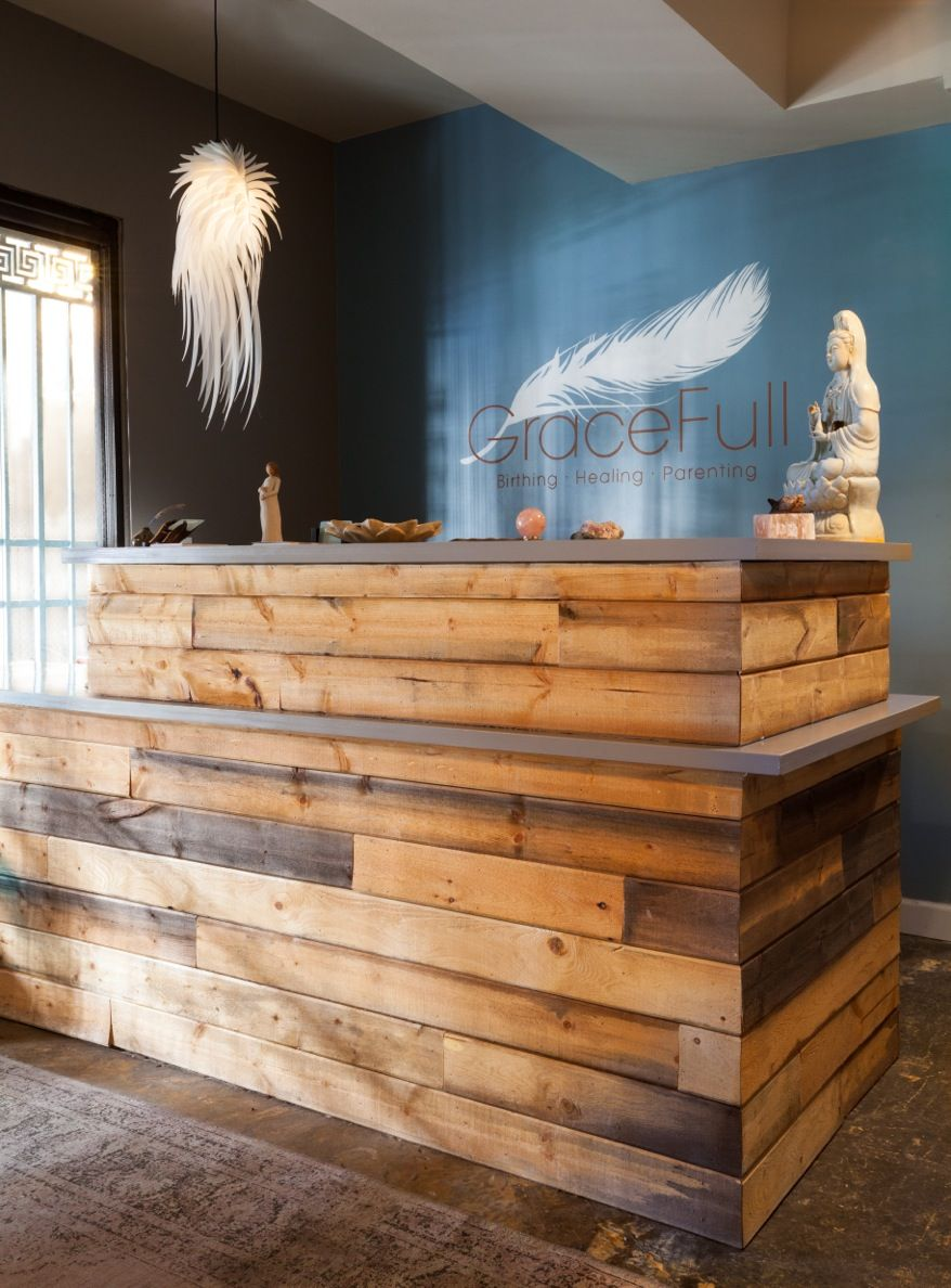 The reclaimed wood reception area designed by rosa beltran for Los angeles reclaimed wood