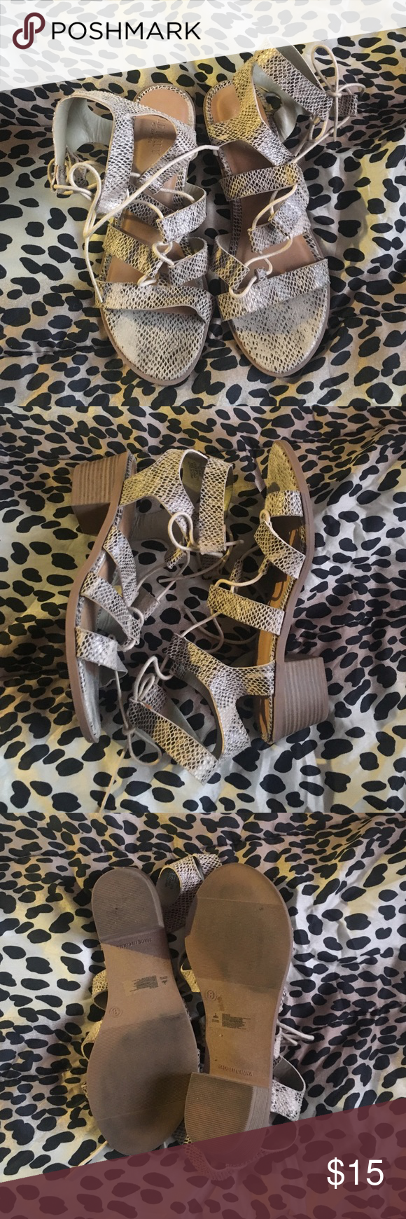 Sandals. Heeled gladiator sandals with adjustable laces. Worn a couple times, good condition. Inside of straps in the left foot has two stains, and the snake print is a little worn on some parts of the shoes (pics above). Pls feel free to ask for more pics. Old Navy Shoes Sandals