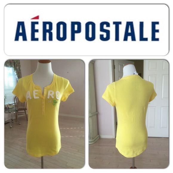 XMAS SALE  Yellow Sexy Top 7 button closure. 96% cotton, 4% spandex. AERO logo. Model measures: 36C Aeropostale Tops