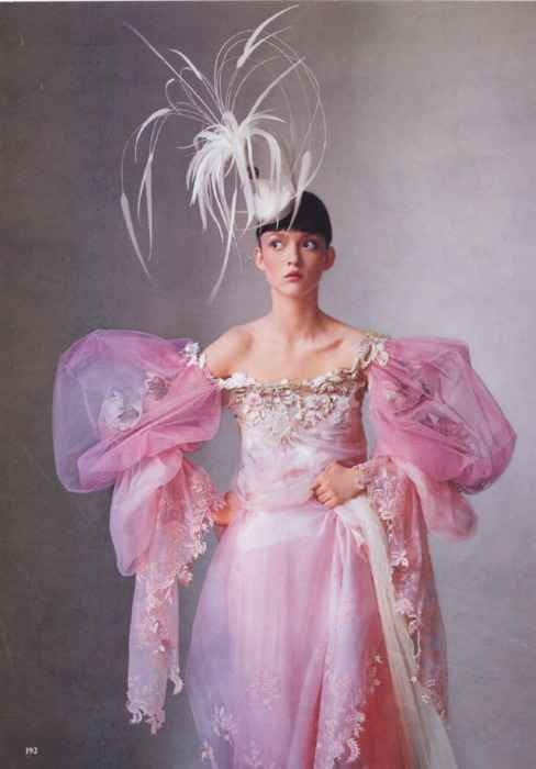 .Lovely pink feathers and the pink dress is outstanding too.