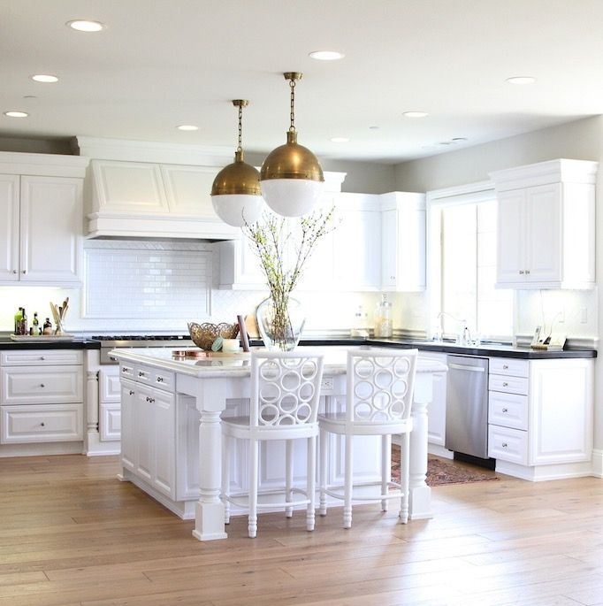 Types Of Kitchen Flooring Ideas: White Kitchen With Gold Accents Features A Pair Of Thomas