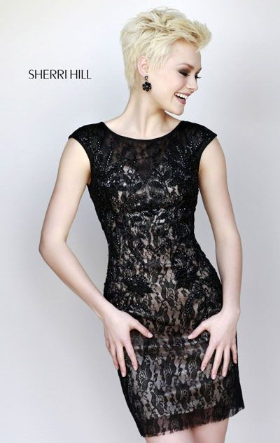 """Dress length: 17"""" (Waist to hem) Shown in: Black Party the night away in Sherri Hill 9721. This charming cocktail dress features a scoop neckline with cap sleeves."""
