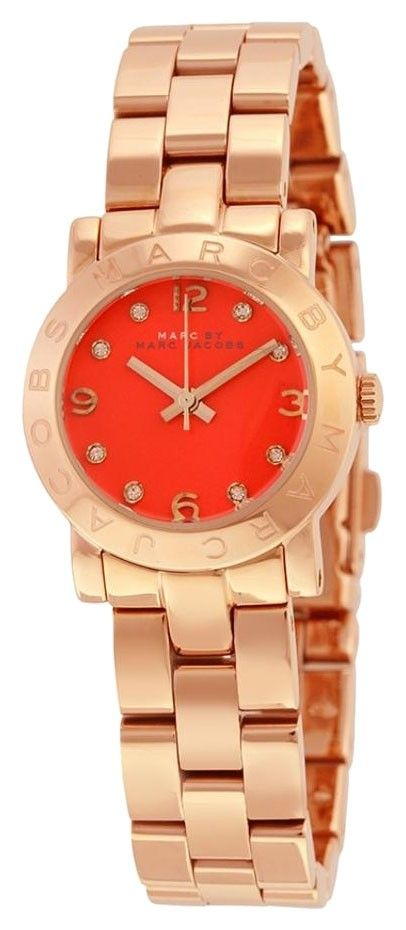 ce15b2626e85 Free shipping and guaranteed authenticity on MBM3305 Amy Mini Orange Dial  Rose Gold-tone Ladies Watch at Tradesy. Rose gold-tone stainless steel case  and ...