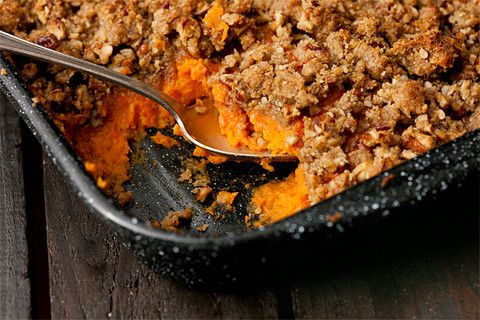 Sweet Potato Casserole with flare! Bourbon and orange zest add loads of flavor without being too boozy-tasting. Then rebake with a crunchy pecan-and-brown-sugar streusel