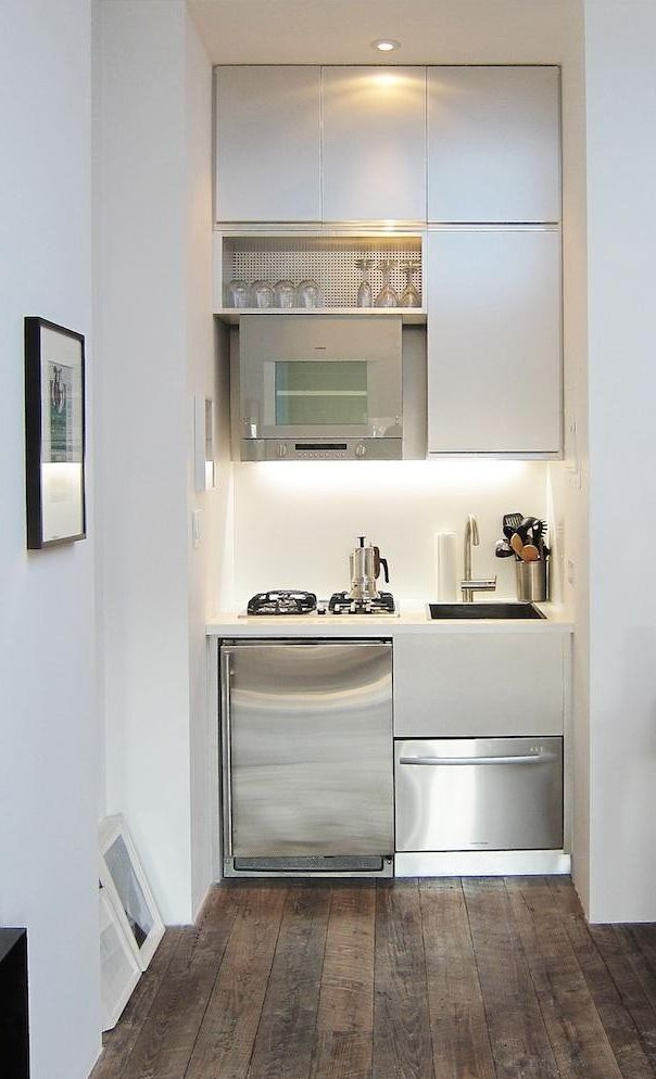 14 Tricks For Maximizing Space In A Tiny Kitchen Urban Edition Remodelista Small Apartment Kitchen Tiny Kitchen Design Studio Apartment Kitchen