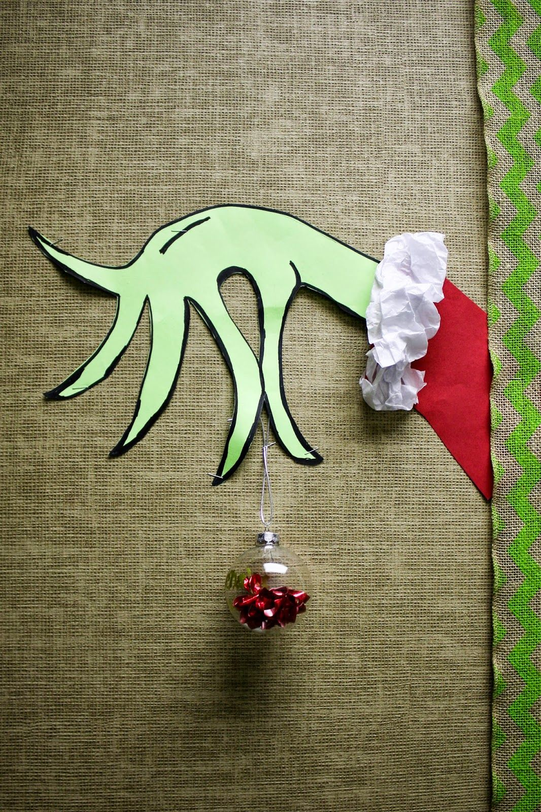 White Christmas Classroom Decorations : Grinch hand on the bulletin board in our classroom