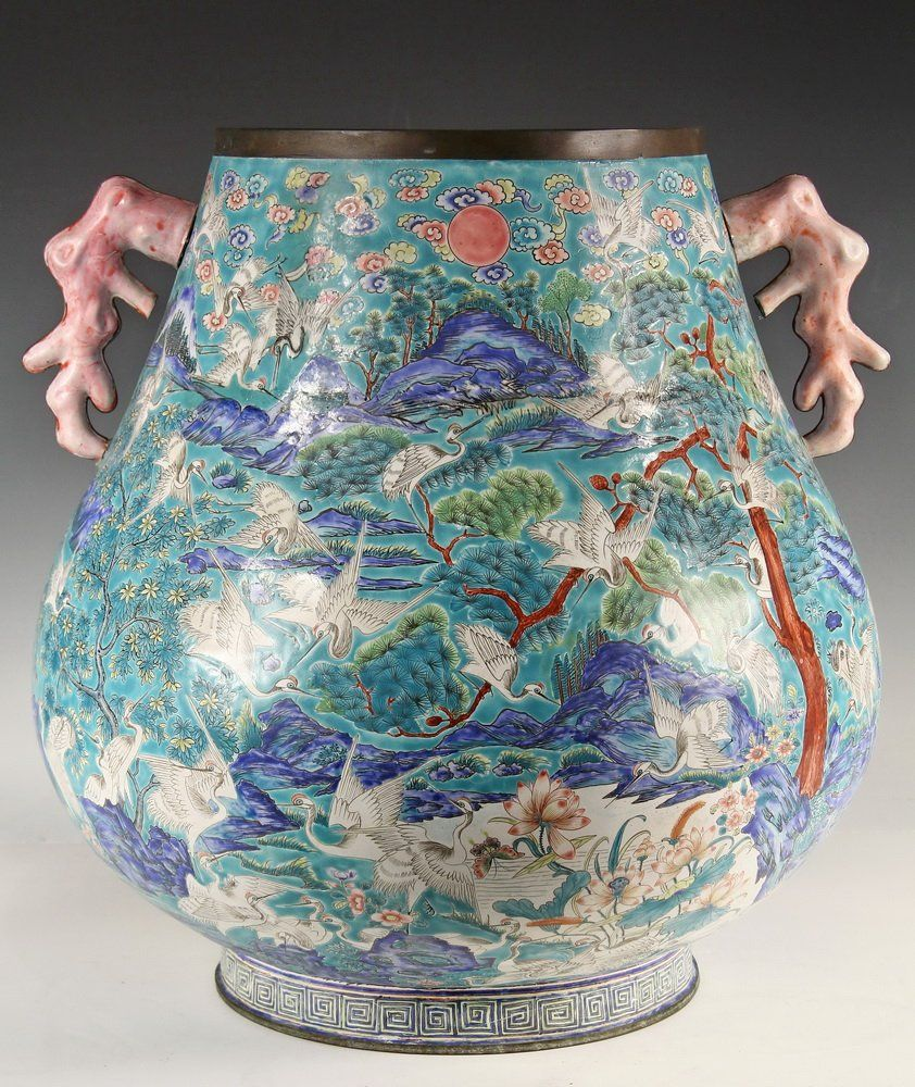 LARGE CHINESE ENAMELED POT - Aqua Field, Ovoid Footed Form with wide throat, brass rim, decorated with cranes in a landscape, having coral form handles. Dao Guang mark on underside.