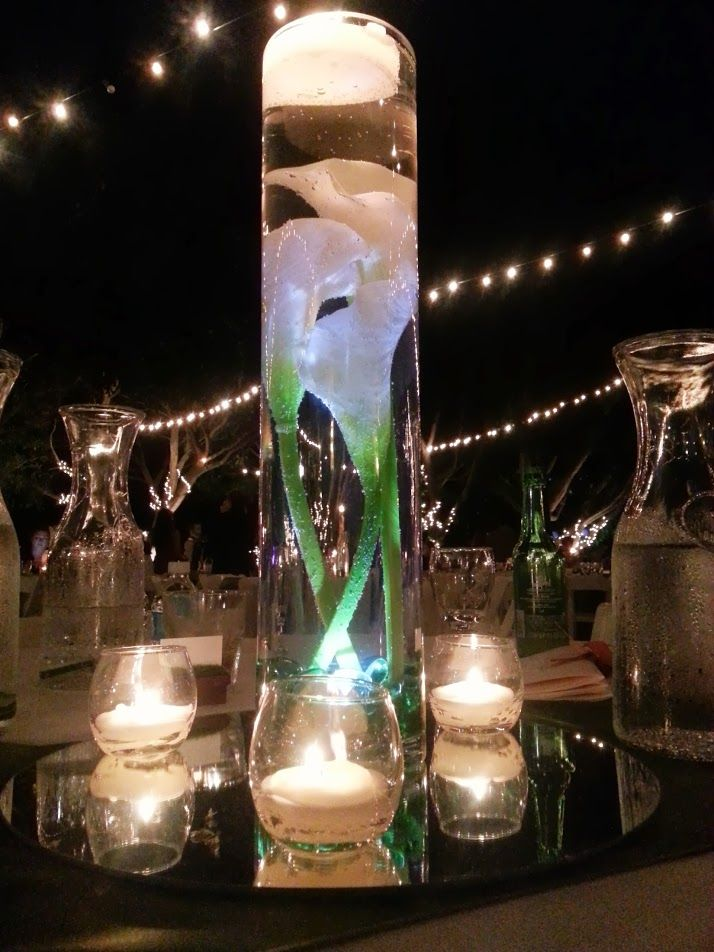 Calla lilly in tall vase with water submersible led light