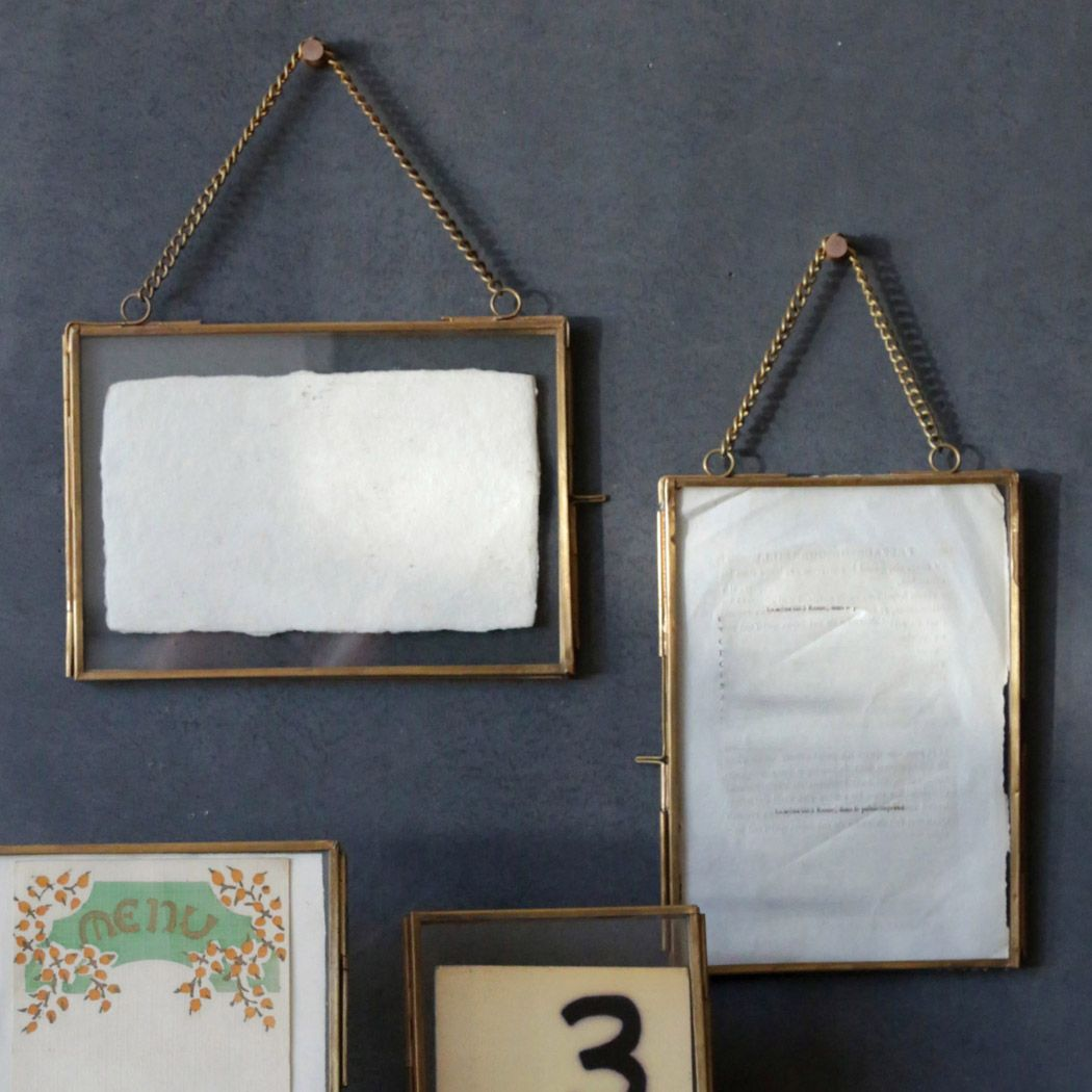 Brass and Glass Frame with Chain is part of Brass Home Accessories Beautiful - This beautiful picture frame features glass panels framed in brass, and it looks very nice with a picture in it  Perhaps a favorite black and white picture would go best with the vintage style of these hanging frames  It hangs using the chain, making it very easy to hang up  Made by Creative Coop, this picture frame is sold individually and comes in the two styles shown  Each holds a 5  by 7  picture  Please choose your style Horizontal 7 25  by 5 5  Vertical  5 75  by 7 5