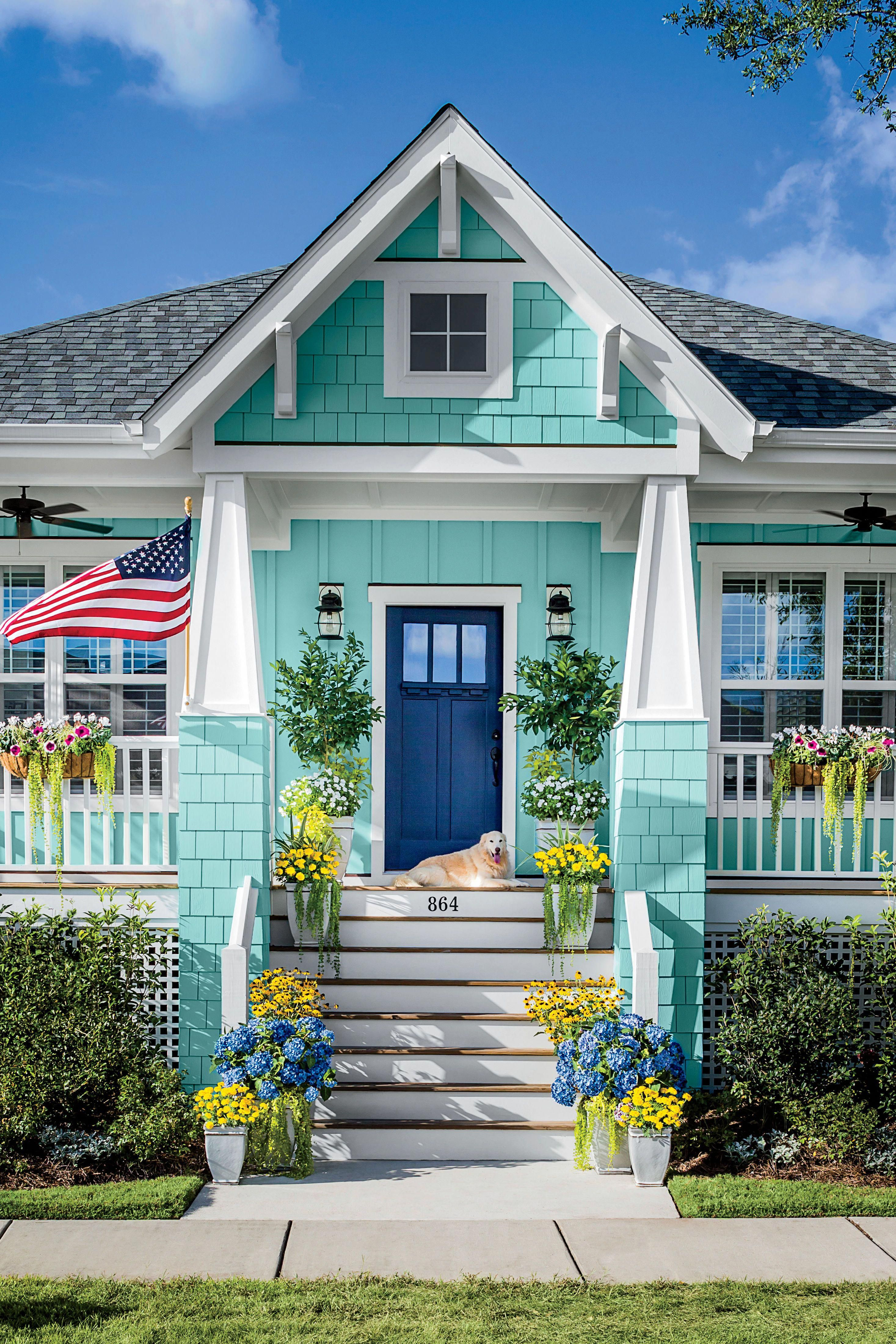 Teal Blue House With Navy Blue Front Door And Dog