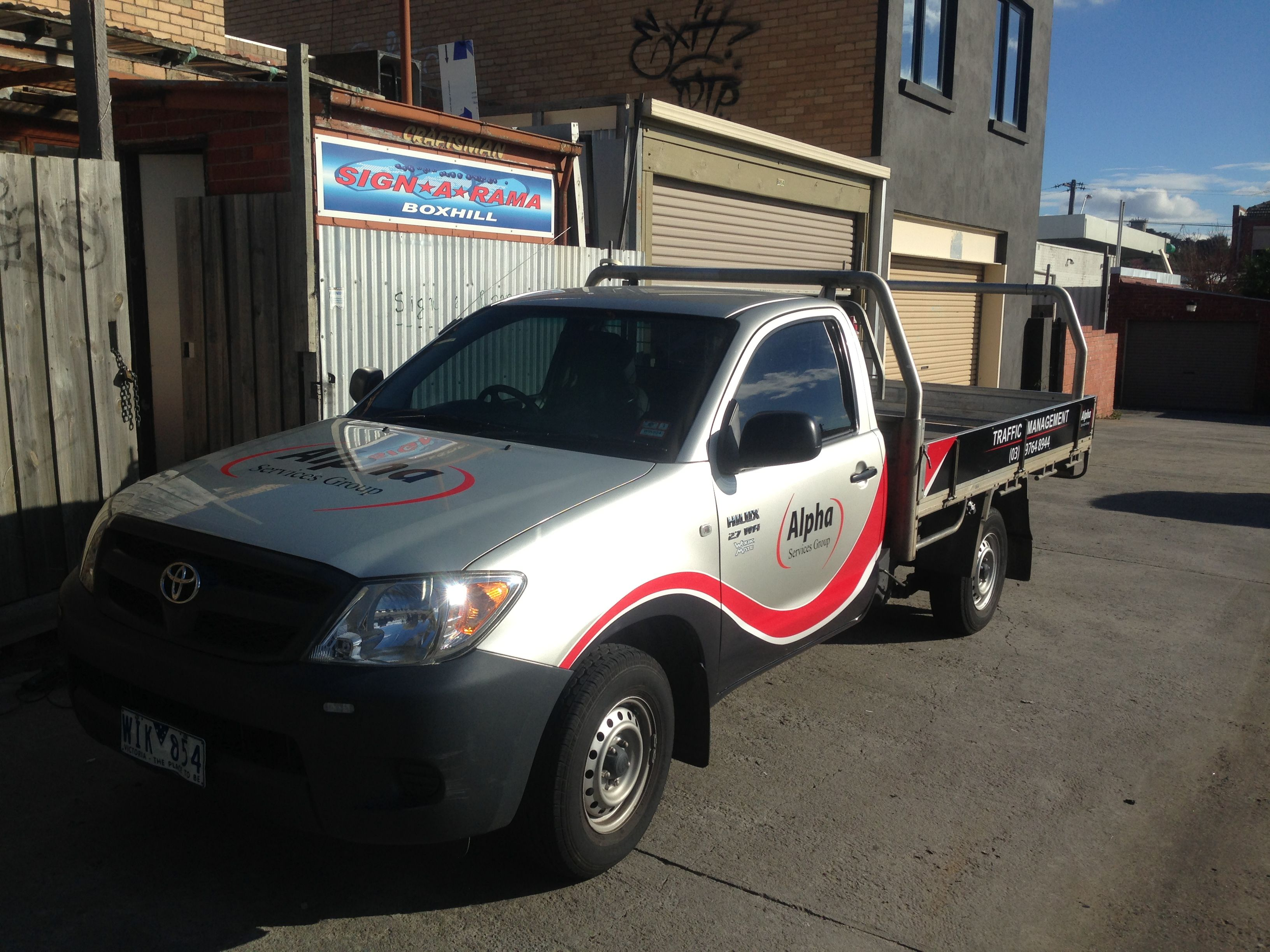 Vinyl stickers and Magnetic strips applied to Toyota Hilux for Alpha Traffic Management. Design and Installation by Sign A Rama Box Hill.