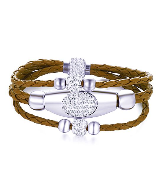 Kents Jewelry Company Brown Three-Row Leather Wrap Bracelet with Swarovski® Crystal   zulily  . $12.99 $89.00  .     Product Description:  Embrace edgy, feminine allure in this braided leather wrap bracelet strung with sterling silver-plated beads and adorned with Swarovski® crystals.      3'' W x 8'' L  .     Magnetic clasp closure  .     Sterling silver-plated brass / Swarovski® crystal / leather  .     Made in the USA