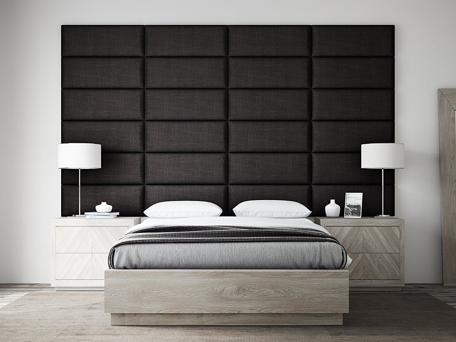 Find a unique wall panel and hang it as a headboard. Like