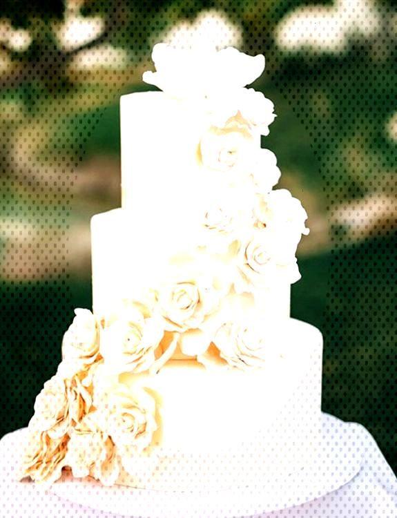 White cake decoration on a white wedding cake creates an elegant look for your Pentney Abbey weddin