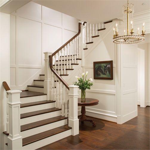 Elegant Mansion Foyers: An Elegant Foyer Stair Wraps A Paneled, Two-story Entry
