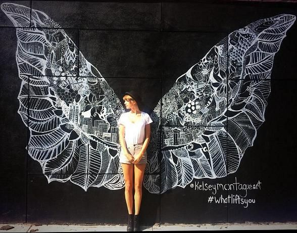 New york city street artist kelsmontagueart is painting a for Angel wall mural