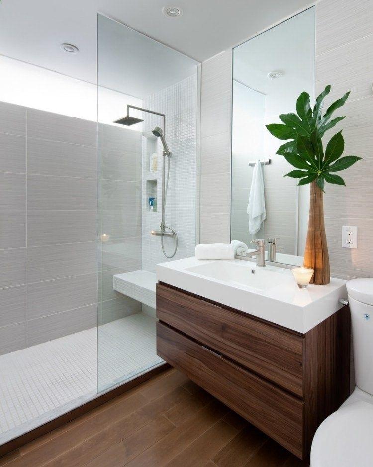 salle de bains avec une douche italienne, carrelage gris et un grand ...