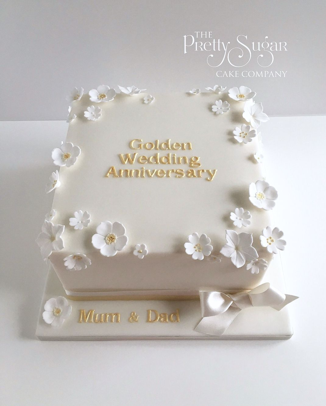 Golden wedding anniversary cake with white and gold blossoms ...