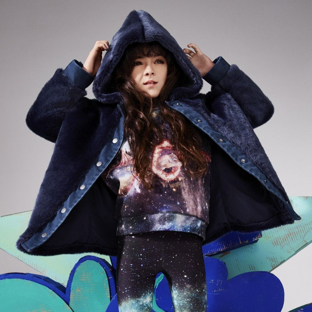 Girls blue synthetic fur coat by Stella McCartney. This 'Treasure' design has a plush fur feel with blue denim trims down the front, wrist cuffs and hem. It fastens with logo embossed poppers and is hooded, has side pockets and a silky lining.