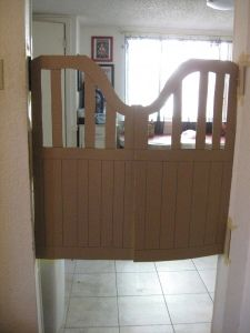 saloon doors made out of cardboard for western themed birthday party  On the gate perhaps? That might be against the rules - door decorations and all... I'll have to check
