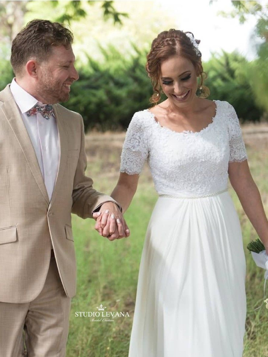 Beautiful modest bride in a boho wedding gown from studio levana